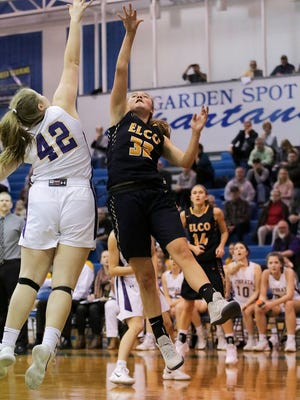 Elco's Amanda Smith goes up for two of her game-high 18 points against the defense of Ephrata's Madeline Groff during the L-L playoffs last season.