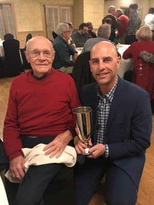 Bill Weik, left, poses with club champion Stuart Hanford during a recent event honoring Weik on his 100th birthday and 60 years as a Lebanon Country Club member.