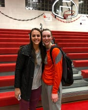 Palmyra senior Olivia Richardson, right, celebrated reaching the career 1,000-point club with older sister Carly, also a 1,000-point club member, after Tuesday's win over Susquehanna Township.