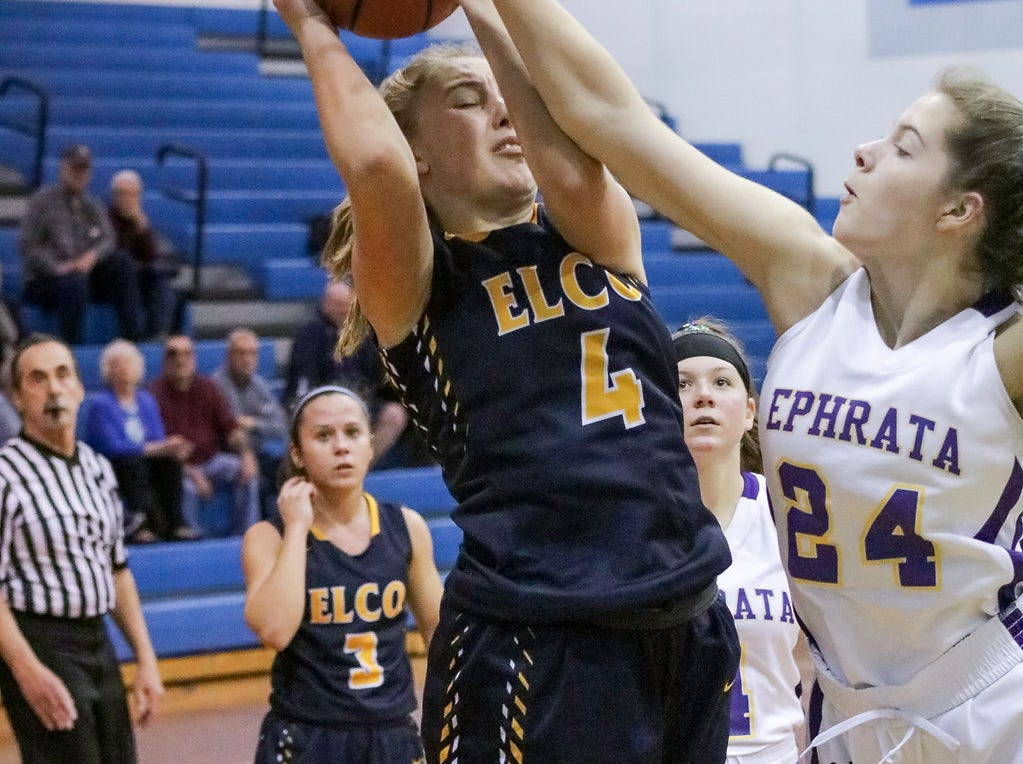 Elco's Kailey Eckhart tries to get a shot up against Ephrata's Hannah Plowmaker.