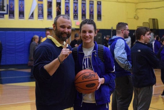 Northern Lebanon's Zara Zerman and head coach Ken Battistelli were all smiles after Zerman reached the career 1,000-point milestone in Thursday's win over Tulpehocken.