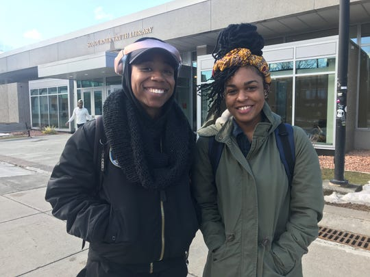 Wajidah Heyward (left) and Dominique McGue (right) stand outside of Sojourner Truth Library on the SUNY New Paltz campus on Friday. They said they don't want the story of two students being charged with concealing a corpse to hurt the college's reputation, because they see the alleged crimes as a family issue.