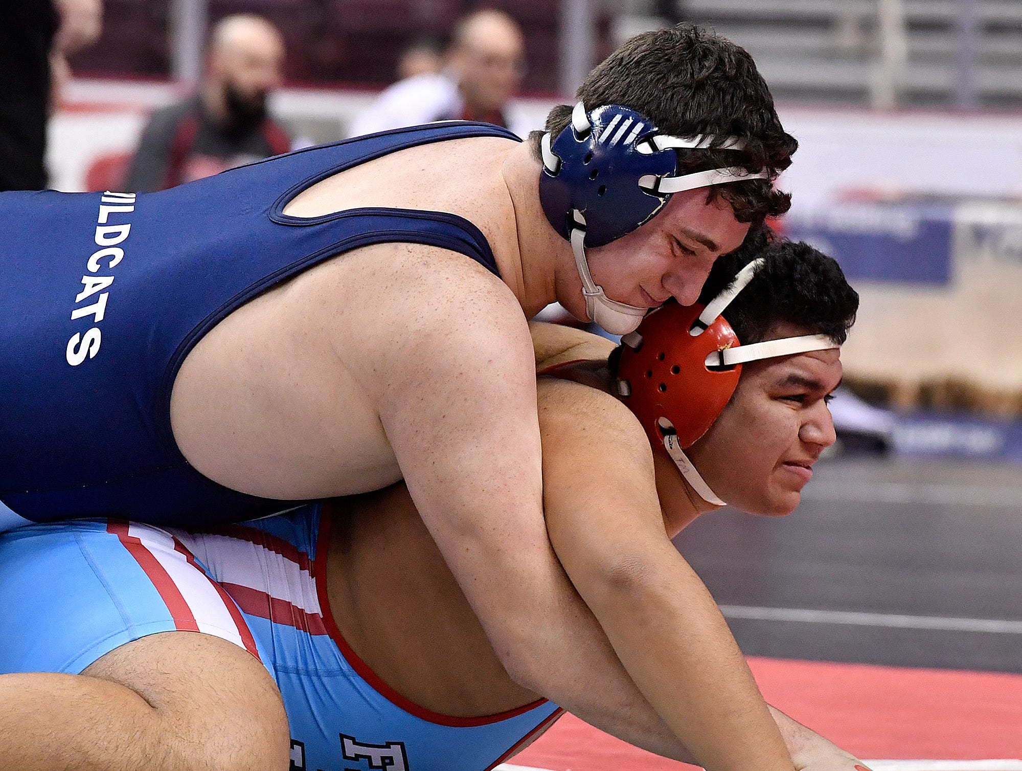 Dallastown's Raymond Christas gets the take-down on Jose Lake of Father Judge during the 285 pound match of PIAA Team Wrestling at Hershey's Giant Center, Thursday, February 7, 2019.