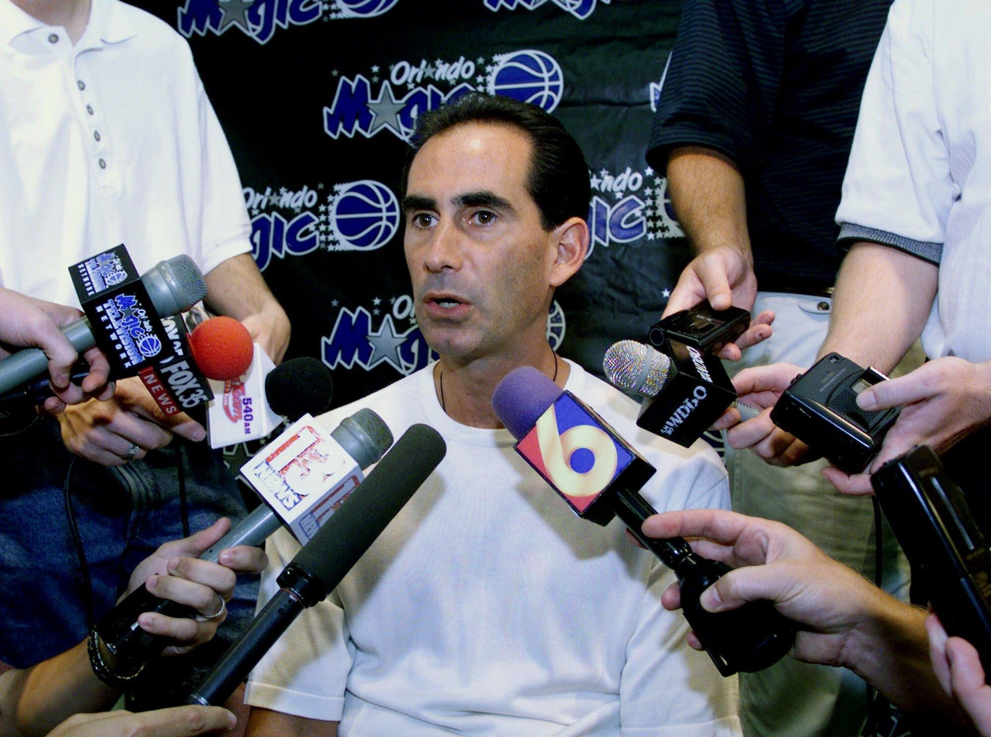 Orlando Magic's General Manager John Gabriel is surrounded by reporters at the Magic practice facility in Orlando, Fla. Tuesday, Aug. 3, 1999.