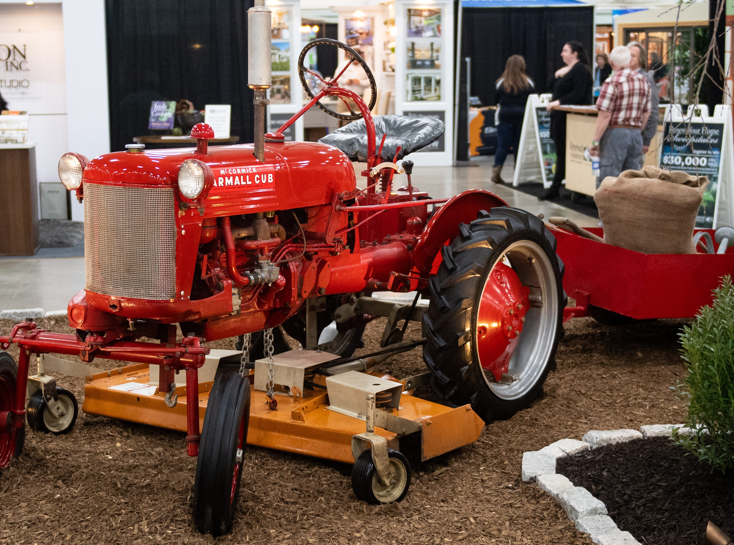 Farming equipment is sprinkled throughout the Home & Garden Show, February 8, 2019.