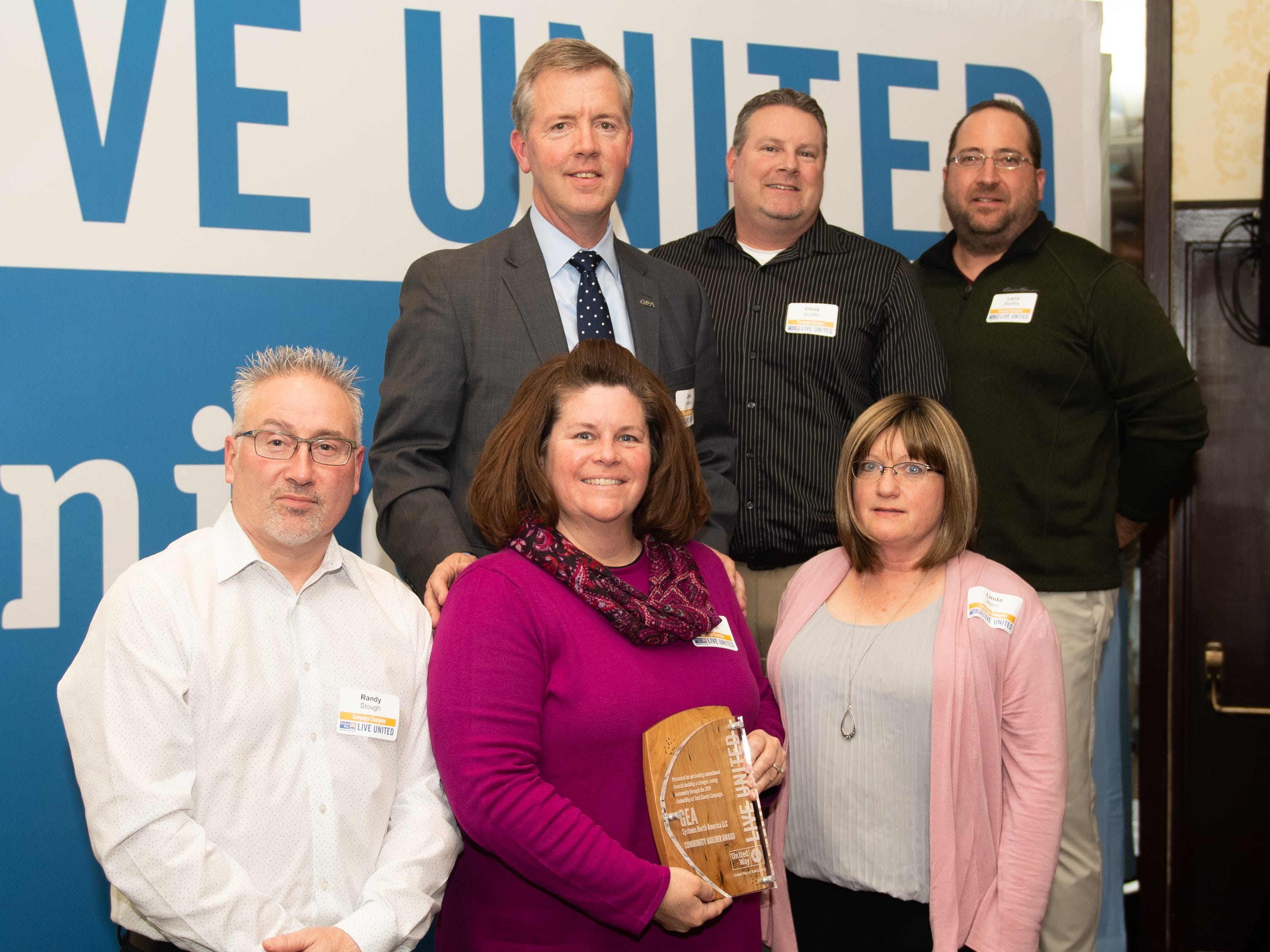 Representatives of GEA Systems North America LLC pose with their Community Builder Award during the 2018 United Way Campaign Celebration, February 7, 2019.