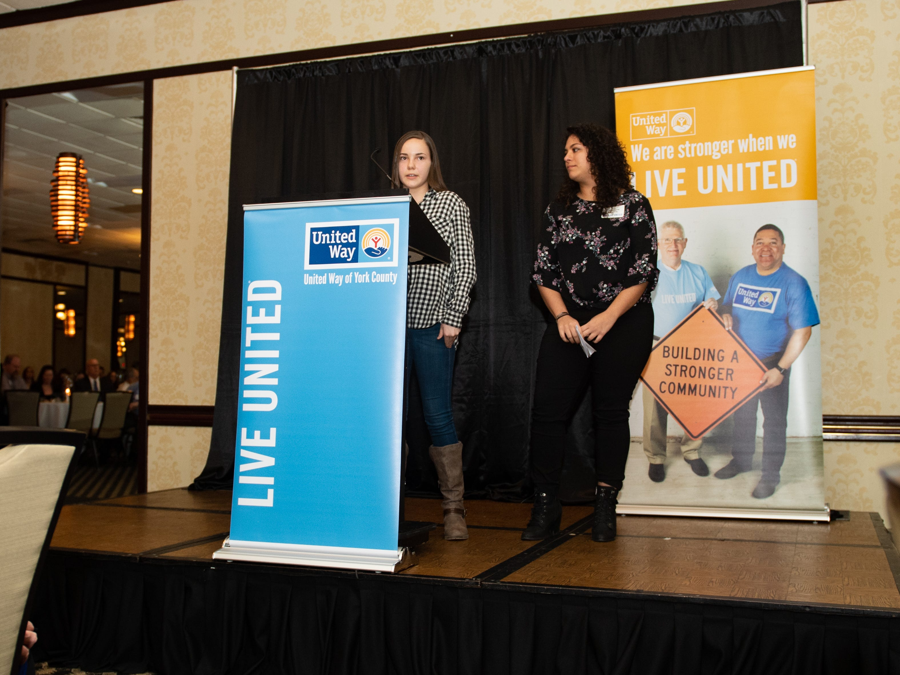 After the company awards were handed out, Cheyenne Gladfelter of the Legacy Athletic Big Brothers Big Sisters of York and Adam Counties (right) and her sister, Justice (left) talk about the importance of giving back, February 7, 2019.