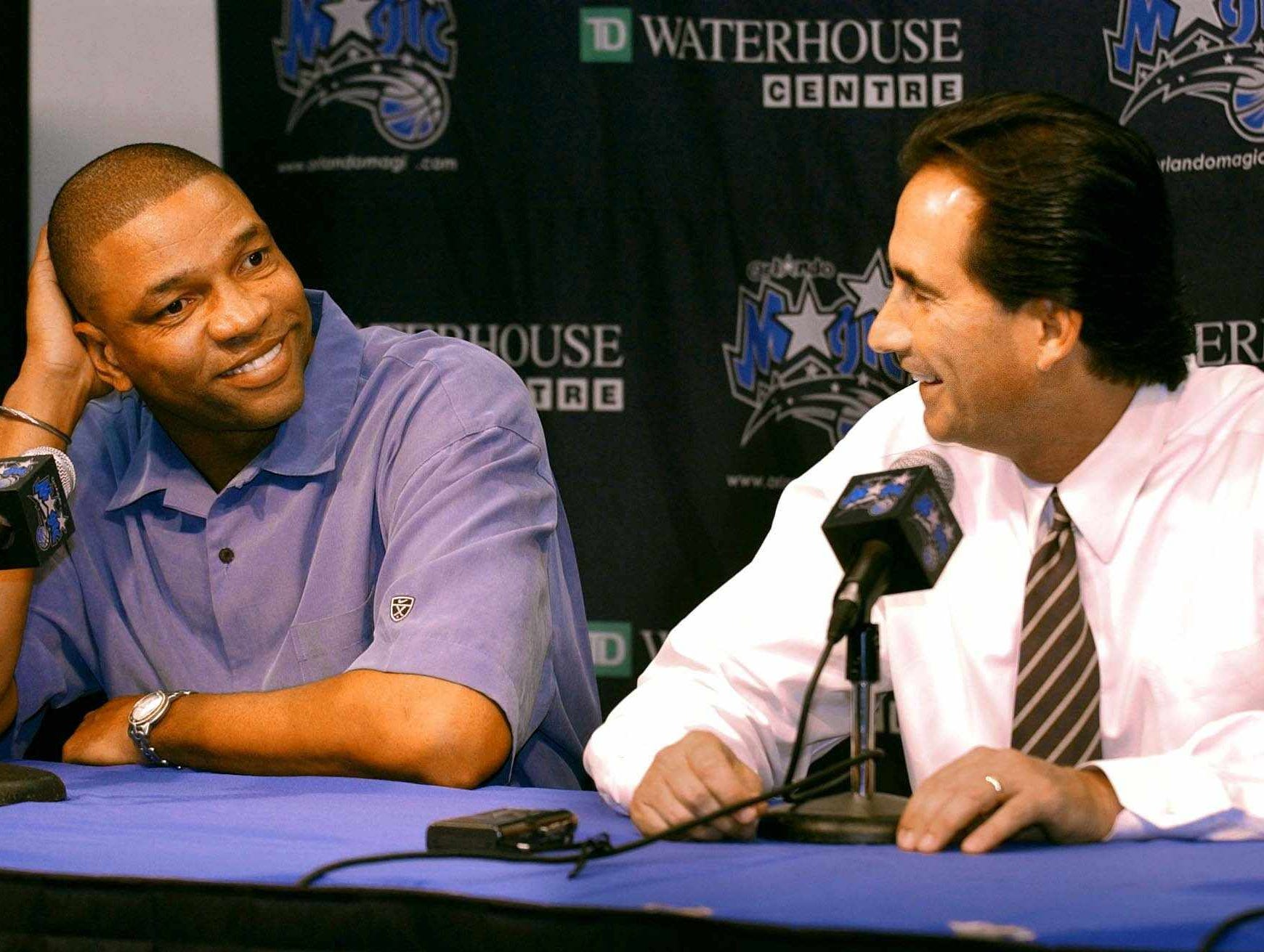Orlando Magic coach Doc Rivers, left, and general manager John Gabriel chat about their first-round NBA draft pick, Reece Gaines in the Magic media room at RDV Sportsplex in Orlando, Fla. Thursday night, June 26, 2003.