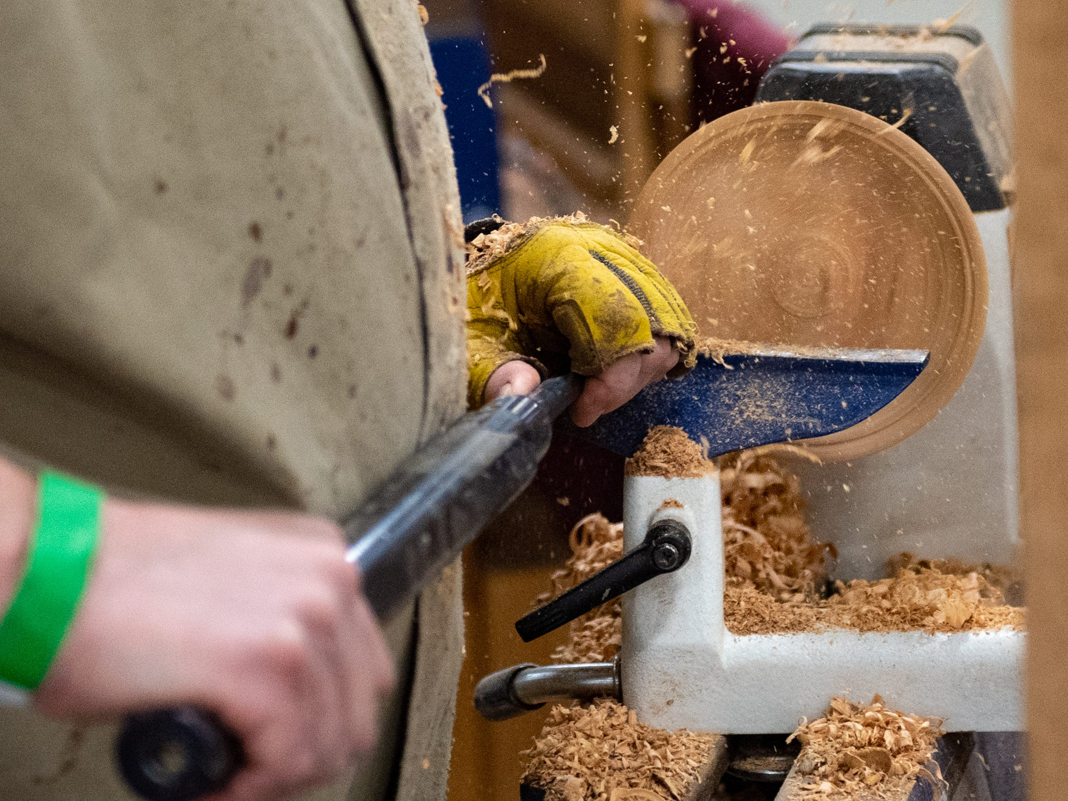 Artisans shape wood into bowls, figurines and other trinkets  during the 2019 Home & Garden Show, February 8, 2019.