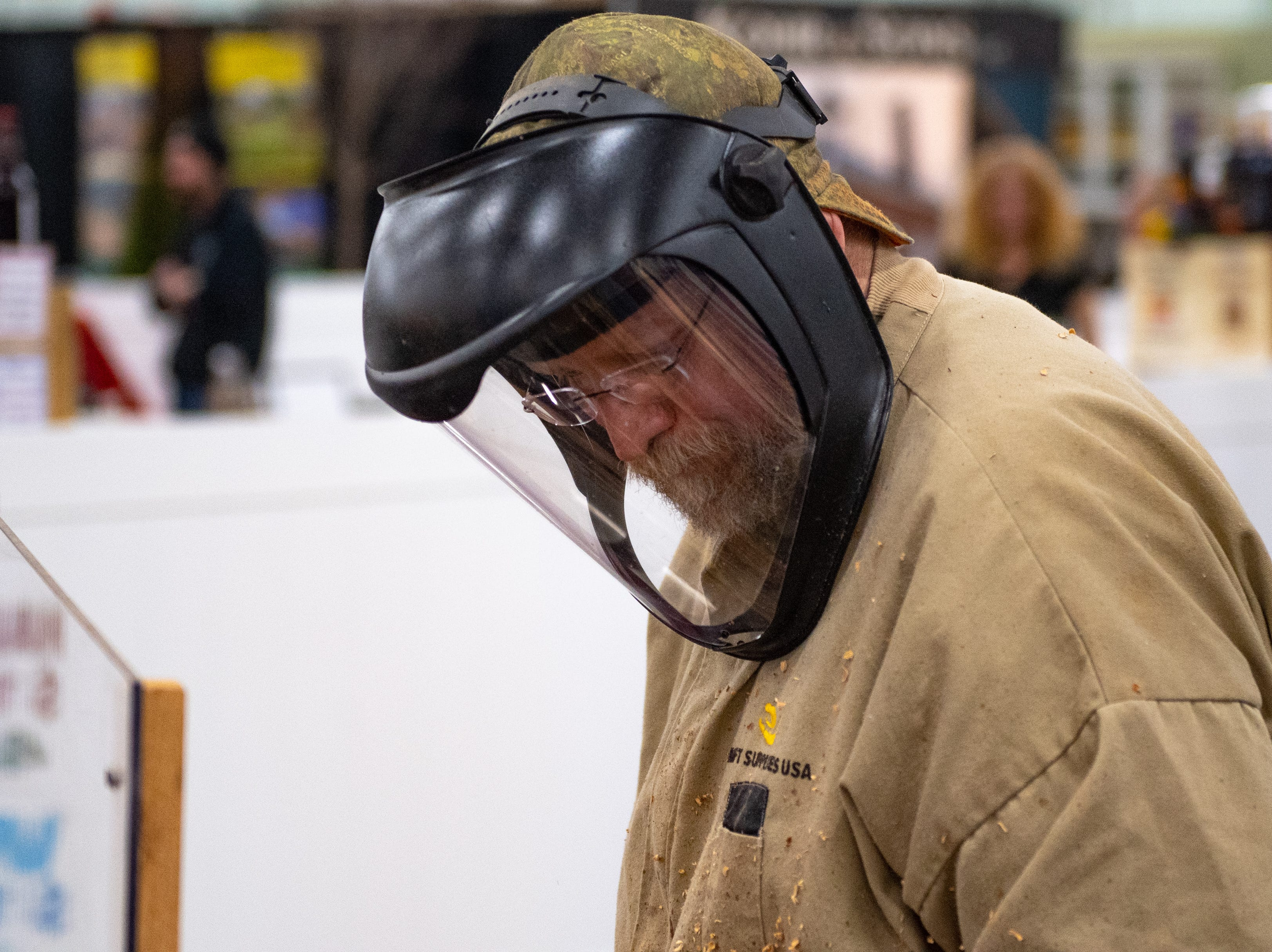 Those handling the wood have to wear protective gear  at the 2019 Home & Garden Show, February 8, 2019.