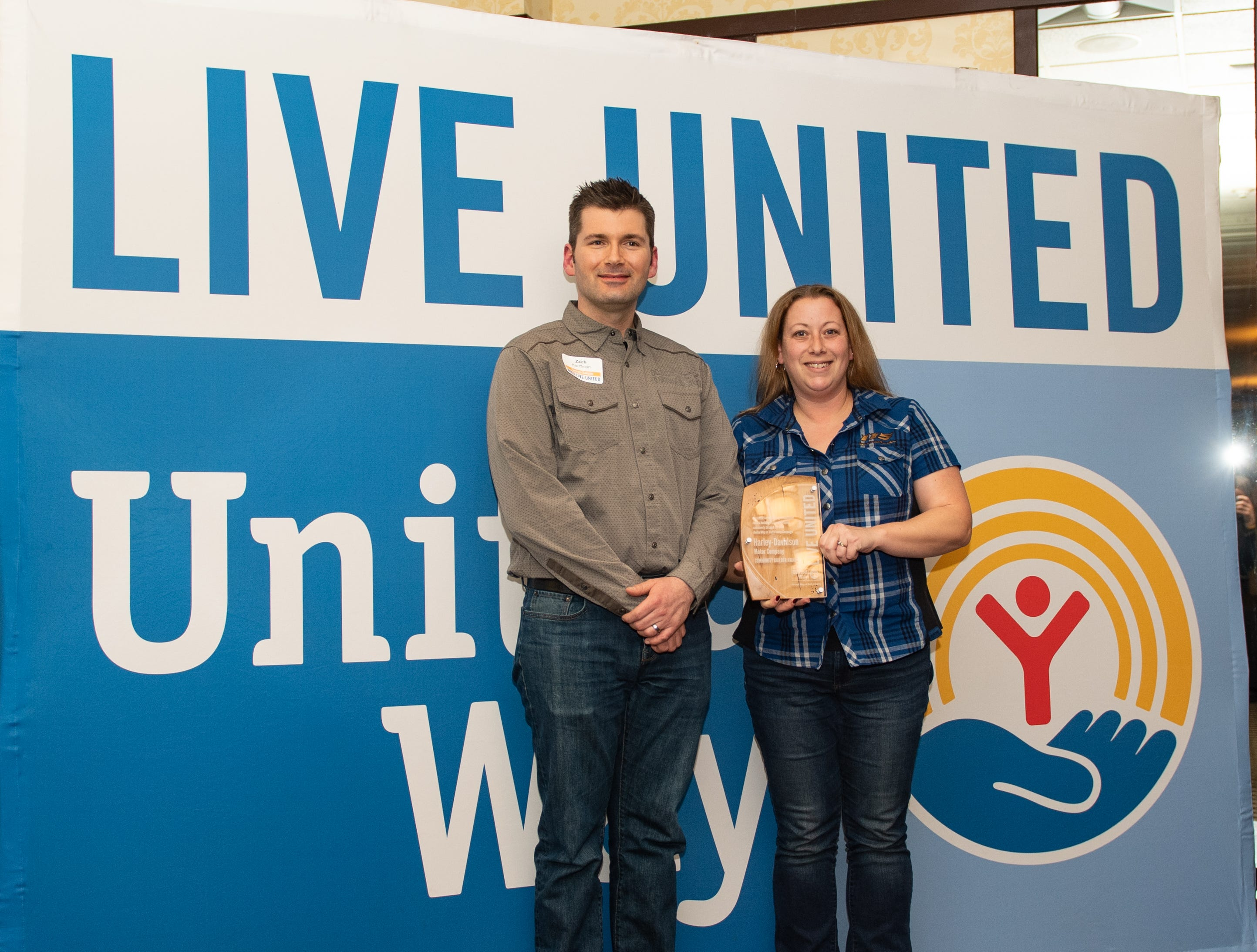 Representatives of Harley-Davidson pose with their Community Builder Award during the 2018 United Way Campaign Celebration, February 7, 2019.