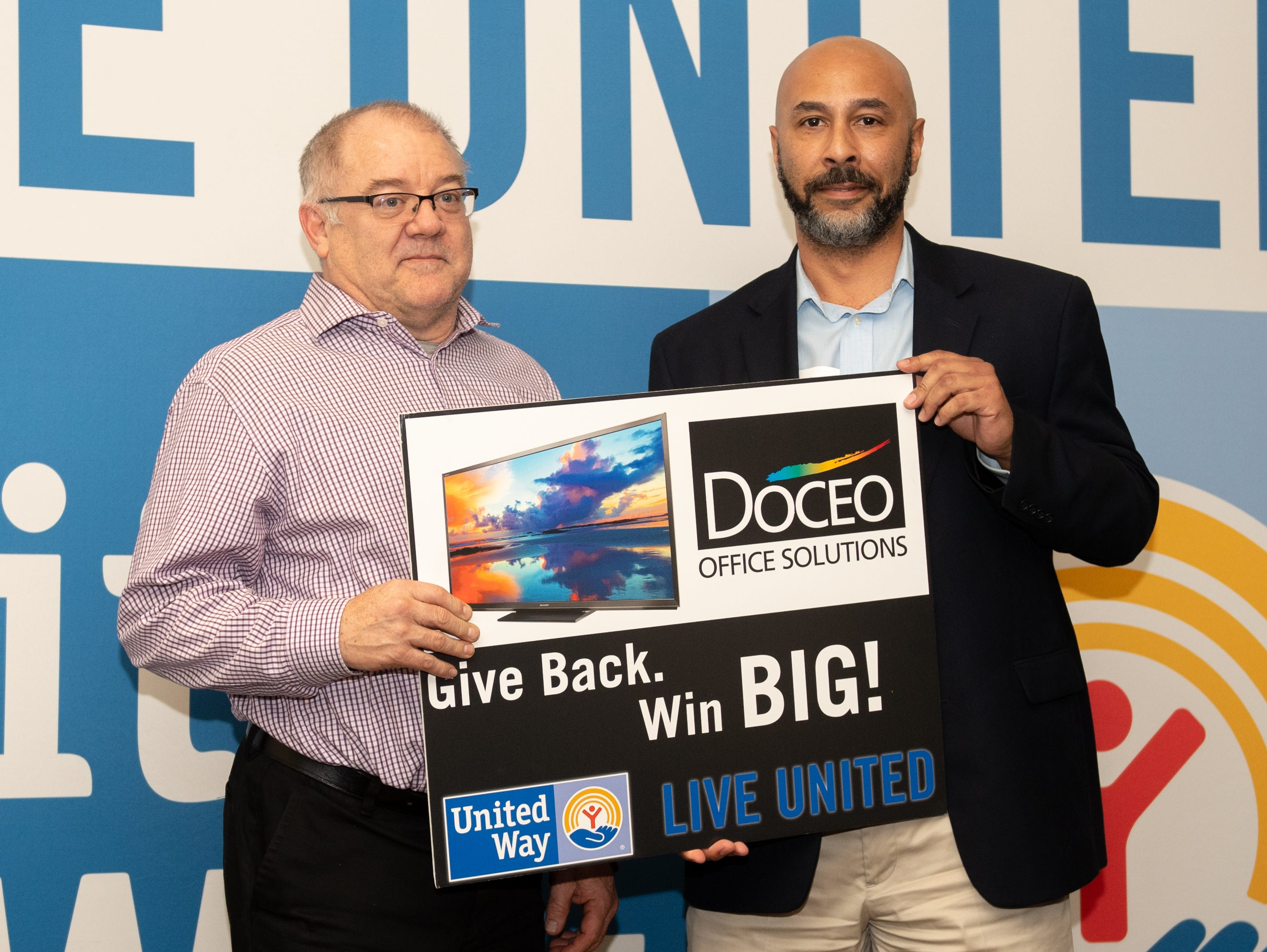Jeff Dombach of Johnson Controls (left) won a Deluxe Large Screen TV during the 2018 United Way Campaign Celebration, February 7, 2019.