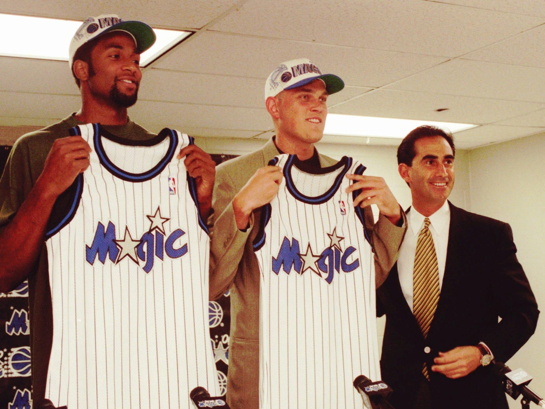 Orlando Magic draft picks Amal McCaskill, left and Brian Evans hold up jerseys after general manager John Gabriel introduced the pair at a press conference in Orlando Thursday afternoon, June 27, 1996.