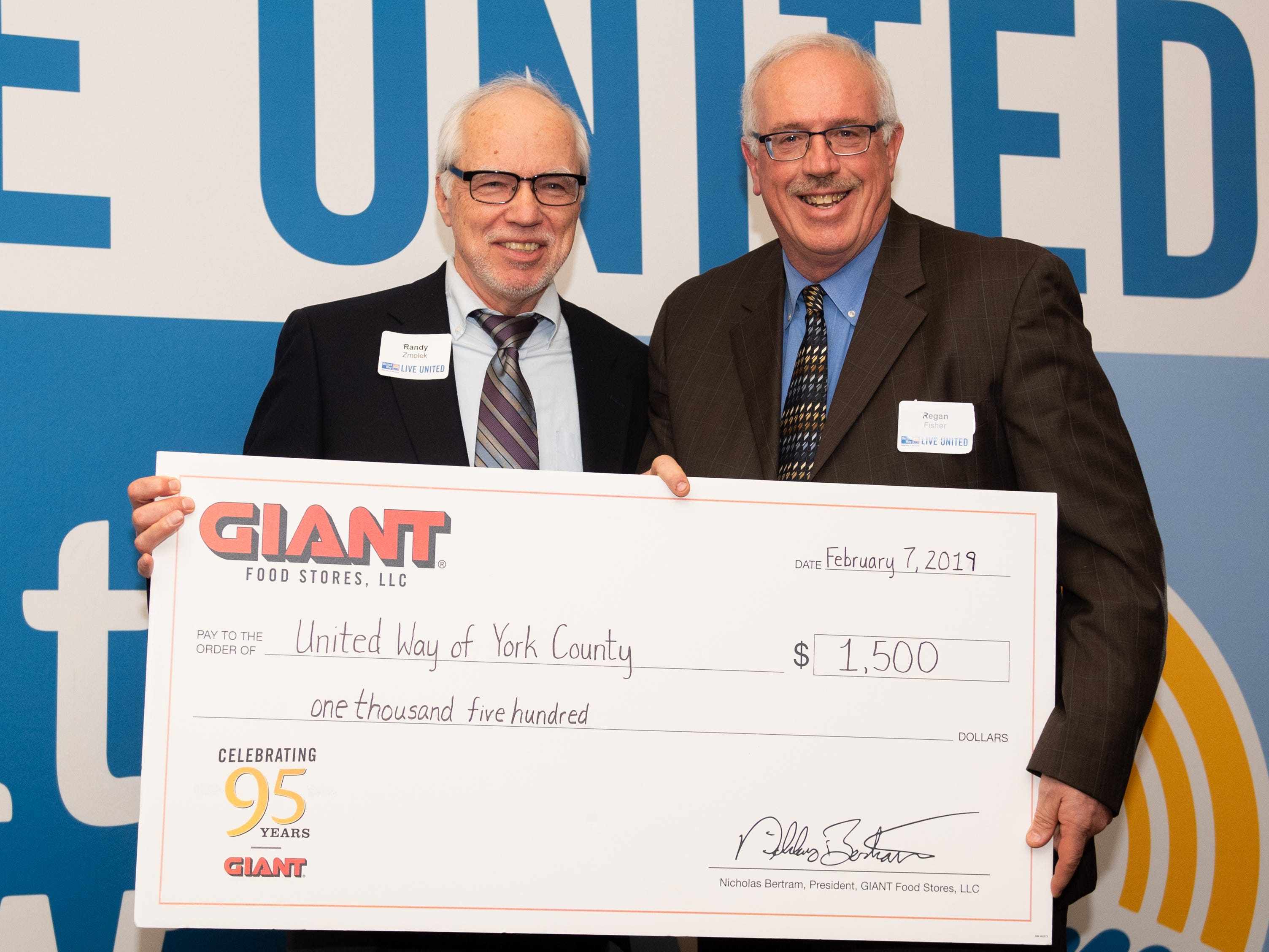 Randy Zmolek of Pixelle Specialty Solutions (left) won $1,500 in GIANT Gift Cards during the 2018 United Way Campaign Celebration, February 7, 2019.