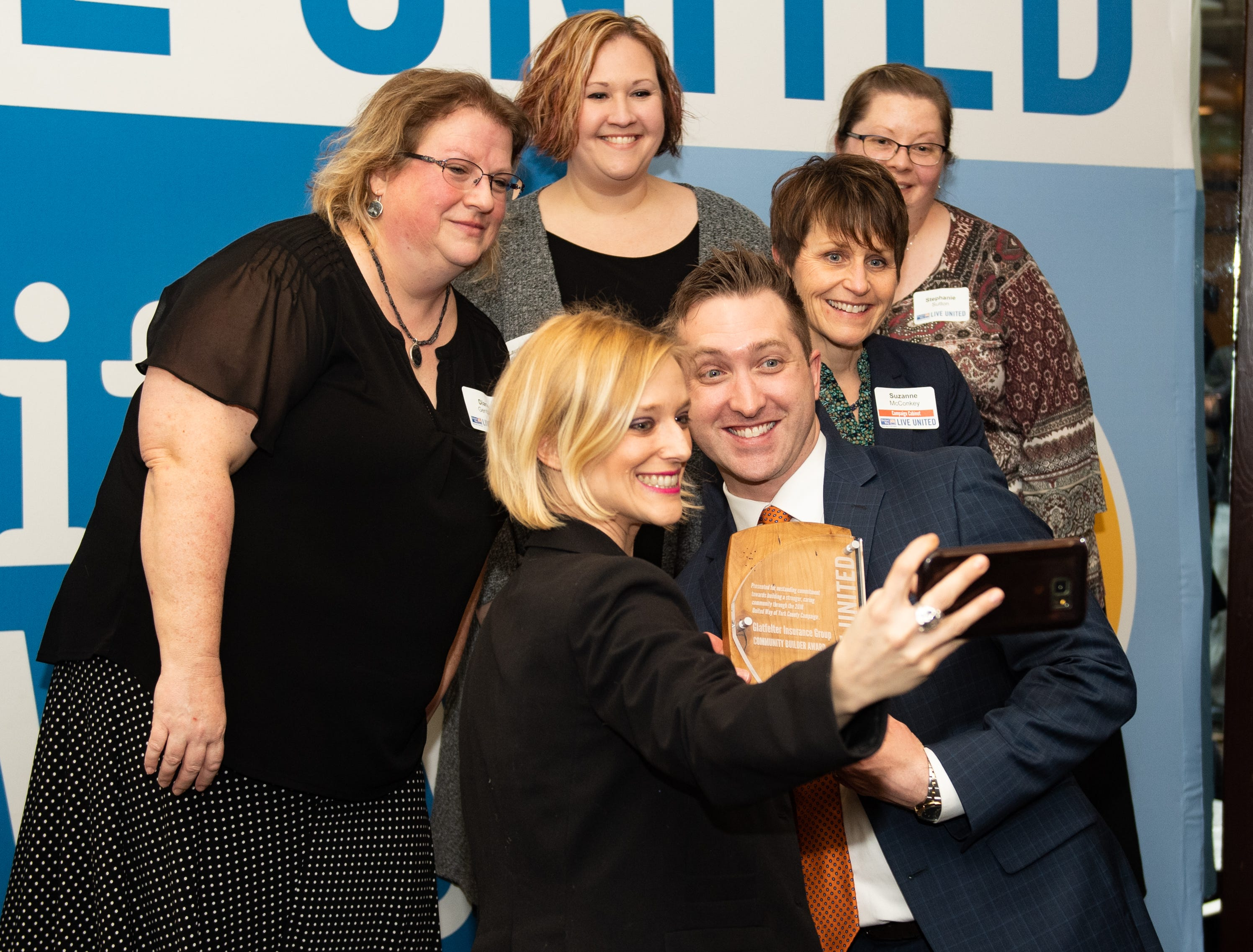Representatives of Glatfelter Insurance Group take a selfie with their Community Builder Award during the 2018 United Way Campaign Celebration, February 7, 2019.