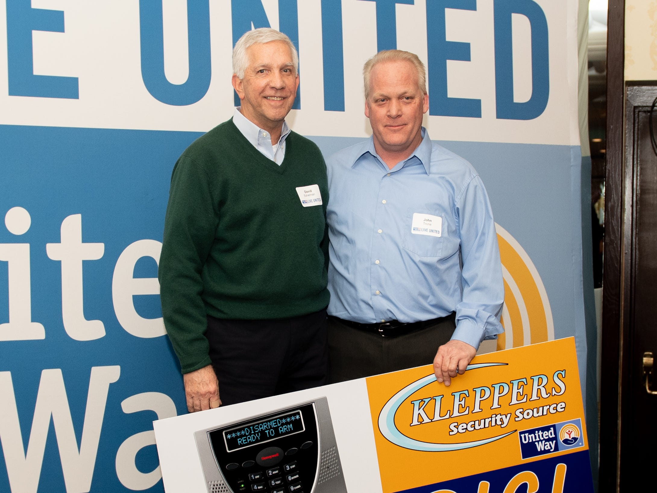 David Eshelman of ACCO Material Handling Solutions (left) won a $1,500 security system during the 2018 United Way Campaign Celebration, February 7, 2019.