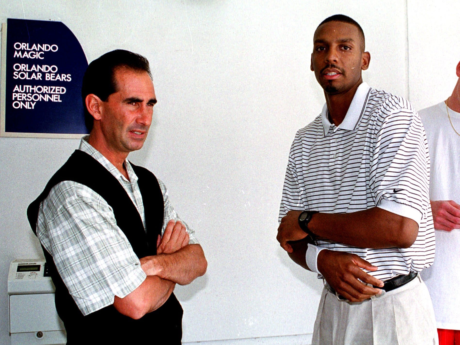 Orlando Magic General Manager John Gabriel left stands with Anfernee Hardaway outside the back door of the Magic's practice facility May 17, 1999, as Hardaway leaves.