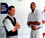 Orlando Magic General Manager John Gabriel left stands with Penny Hardaway outside the back door of the Magic's practice facility May 17, 1999, as Hardaway leaves.