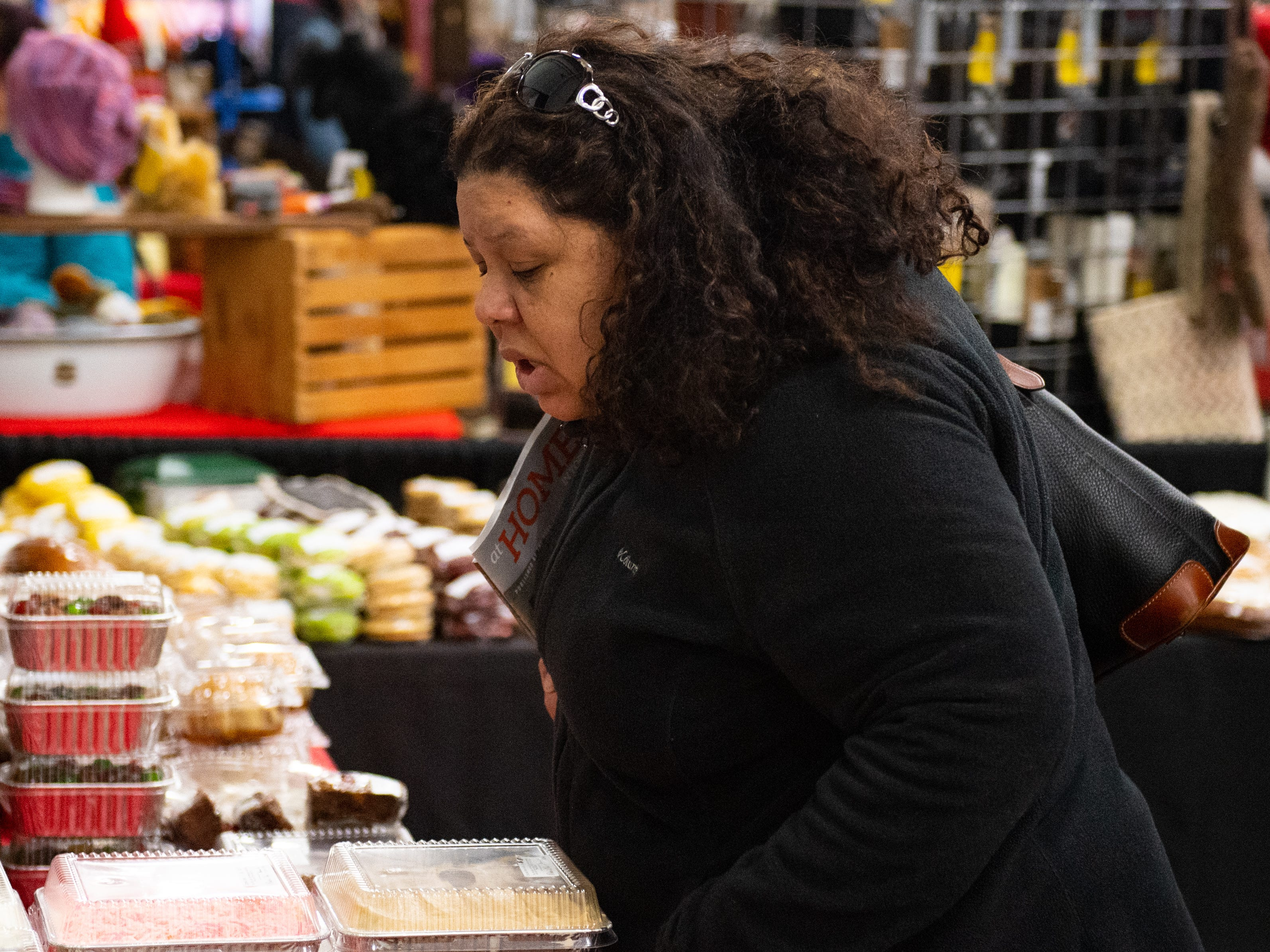 Taisha Wilson looks for the right sweet treat to take home during the Home & Garden Show, February 8, 2019.
