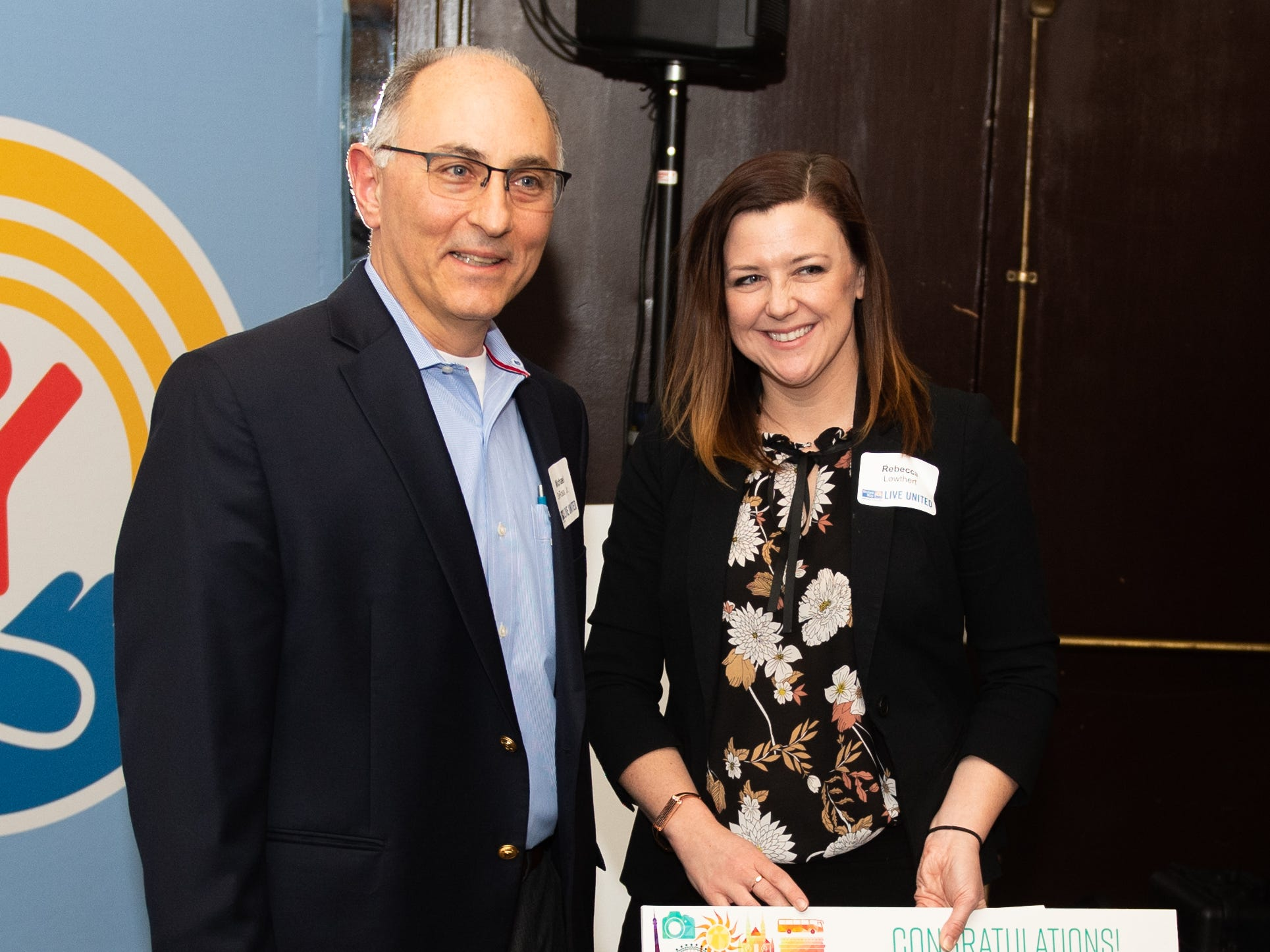 Michael DeRosa of Graham Architectural (left) won a $5,000 Travel Voucher during the 2018 United Way Campaign Celebration, February 7, 2019.