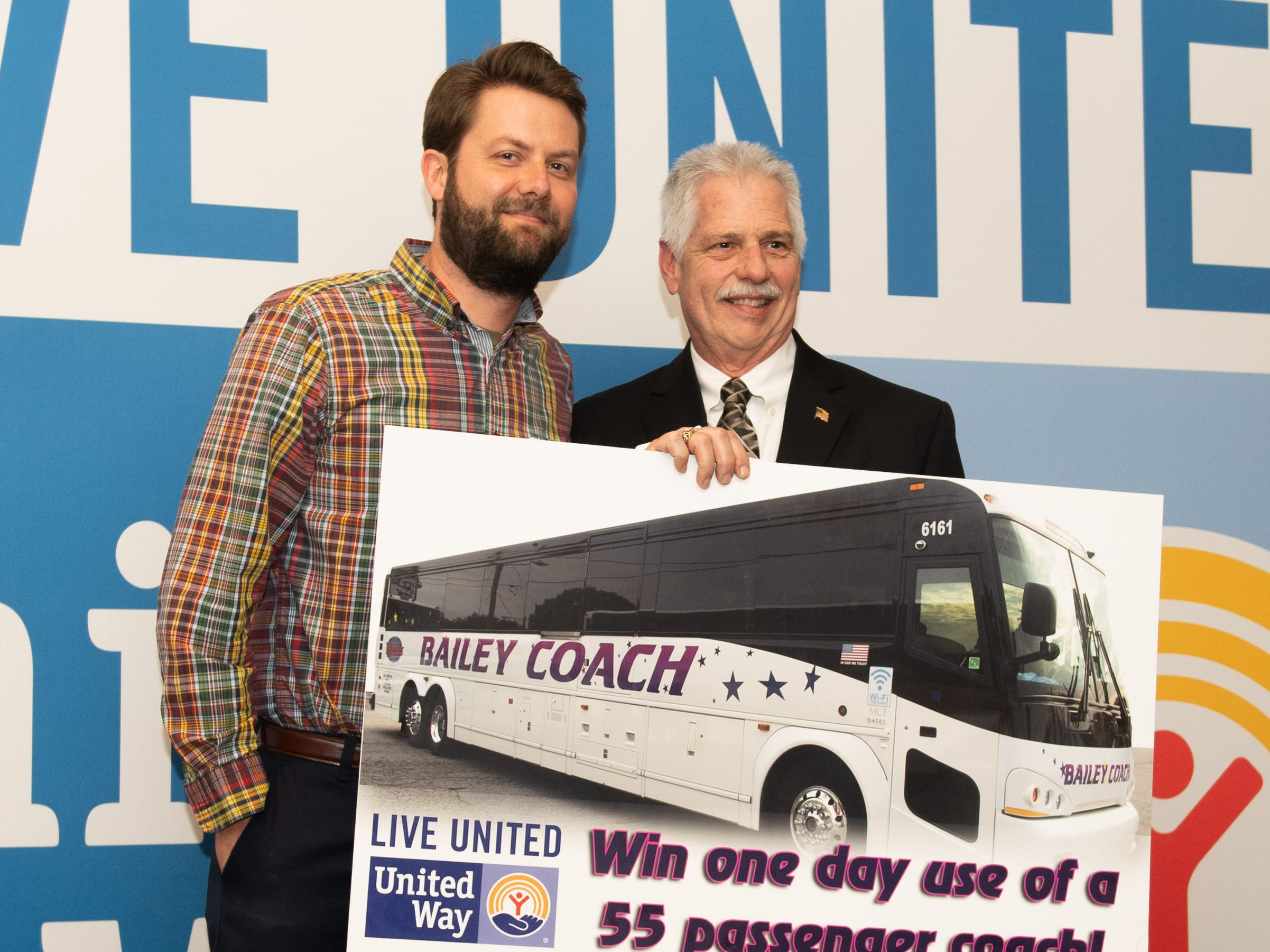 Kevin Krasowski of Graham Architectural (left) won a One-Day All-Inclusive Atlantic City Trip during the 2018 United Way Campaign Celebration, February 7, 2019.