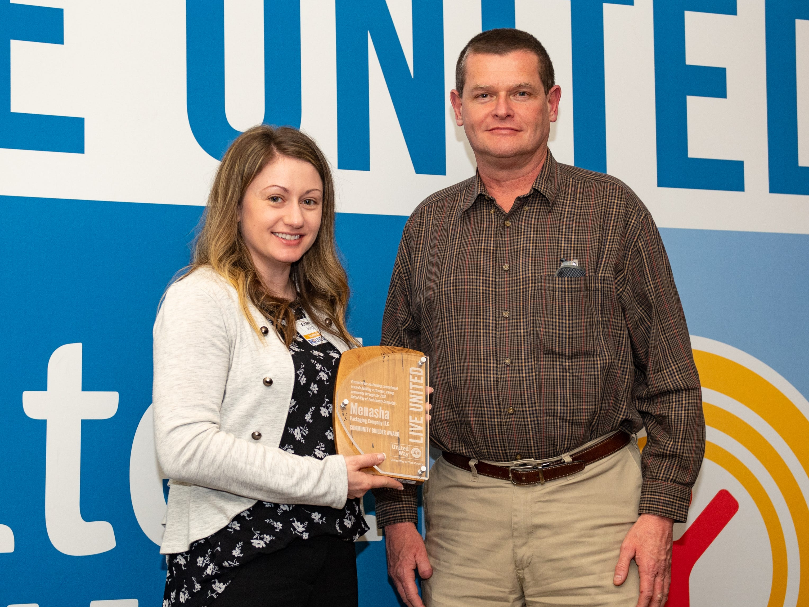 Representatives of Menasha Packaging Company LLC pose with their Community Builder Award during the 2018 United Way Campaign Celebration, February 7, 2019.