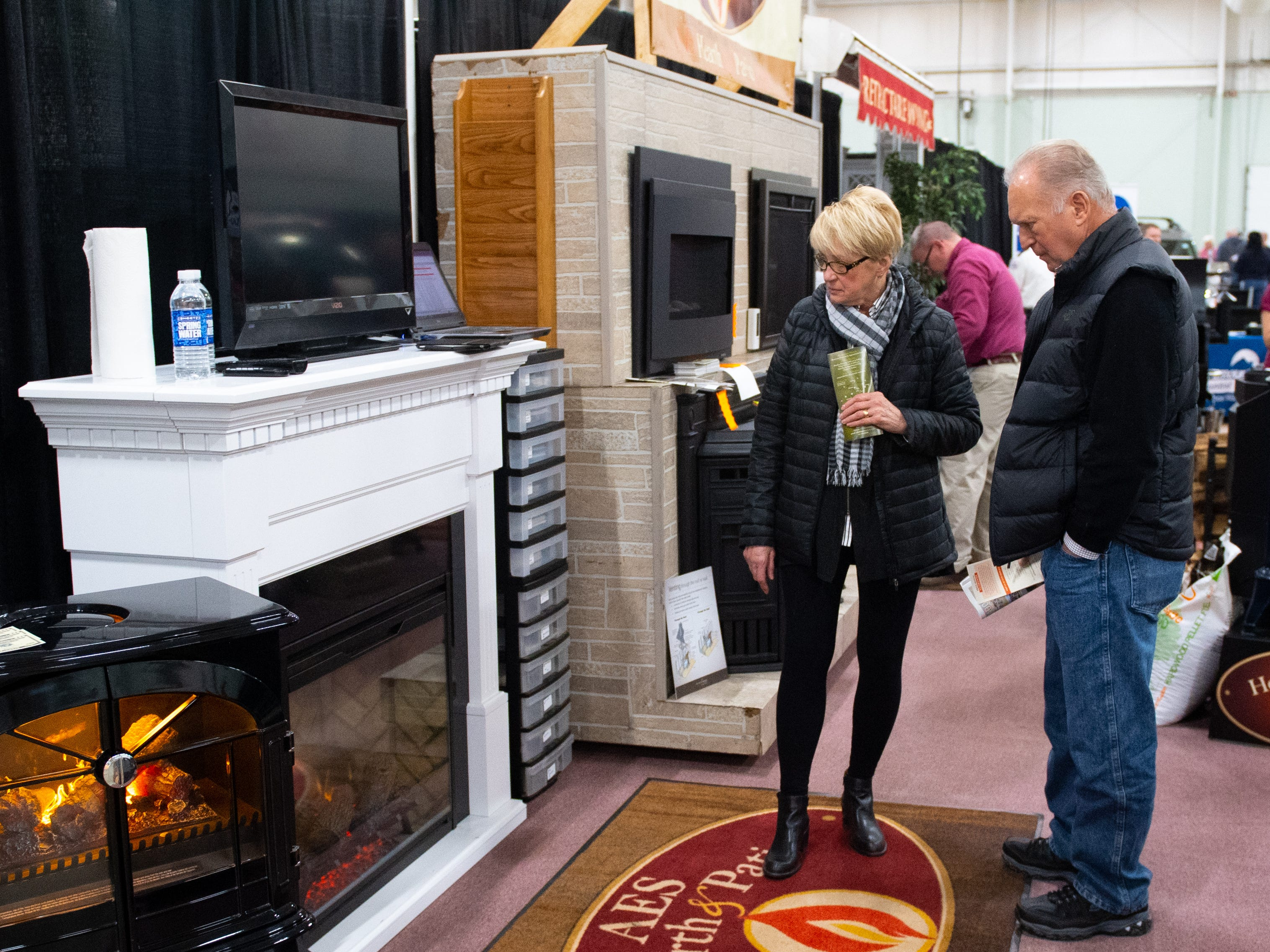 A booth filled entirely with fireplaces sits near the back of the 2019 Home & Garden Show, February 8, 2019.