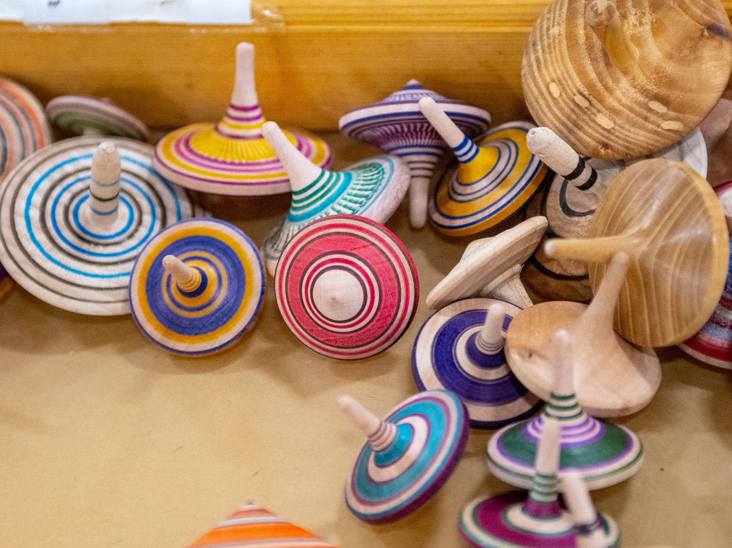 Handmade spinning tops are on sale at the 2019 Home & Garden Show, February 8, 2019.