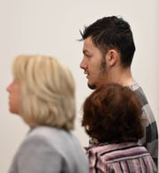 Wilber Martinez-Guzman stands next to his interpreter, center, and his public defender while appearing for a preliminary hearing at the Carson City Justice Court in Carson Ciry, Nev. on Friday Feb. 8, 2019.
