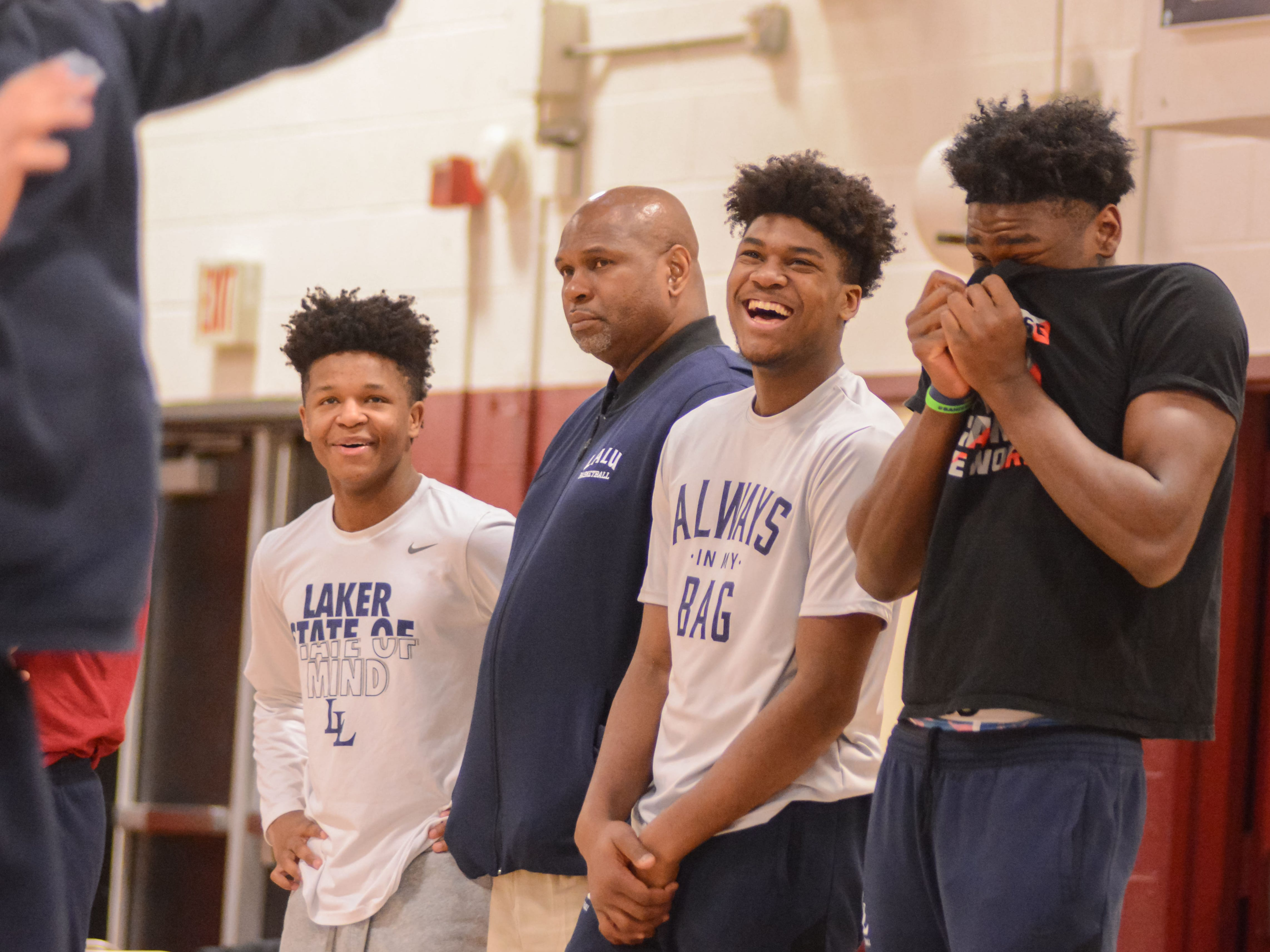 Irondequoit's Gerald Drumgoole, second from right, and former McQuaid star Isaiah Stewart laugh with their La Lumiere teammates and associate coach Jaren Jackson Sr. at a recent tournament in Cumberland, Maryland.