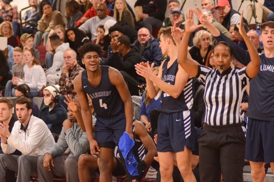 Former Irondequoit star Gerald Drumgoole smiles after a La Lumiere teammate made a 3-point shot in a win over Takoma Academy at the Bob Kirk Invitational in Cumberland, Maryland.