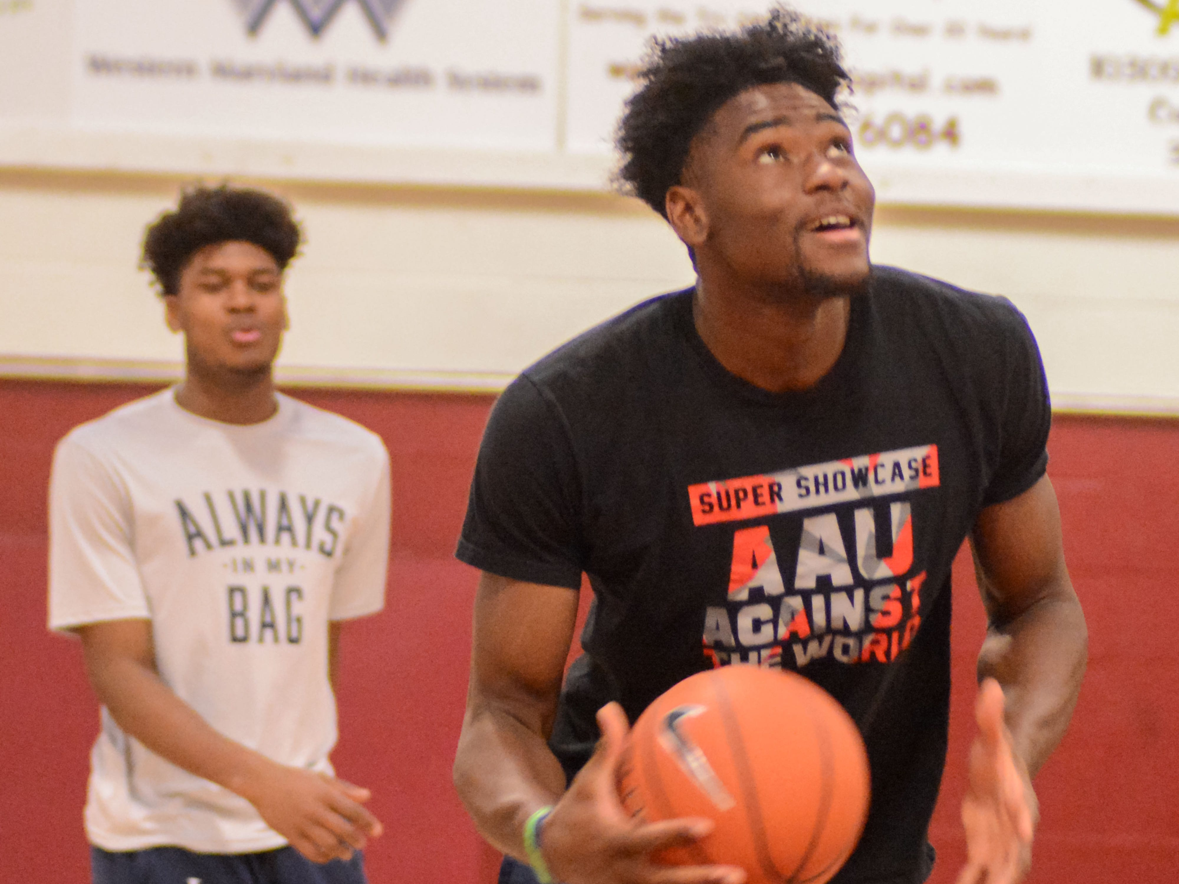 Isaiah Stewart prepares to throw down a dunk as Gerald Drumgoole looks on before a game at the Bob Kirk Invitational in Cumberland, Maryland.