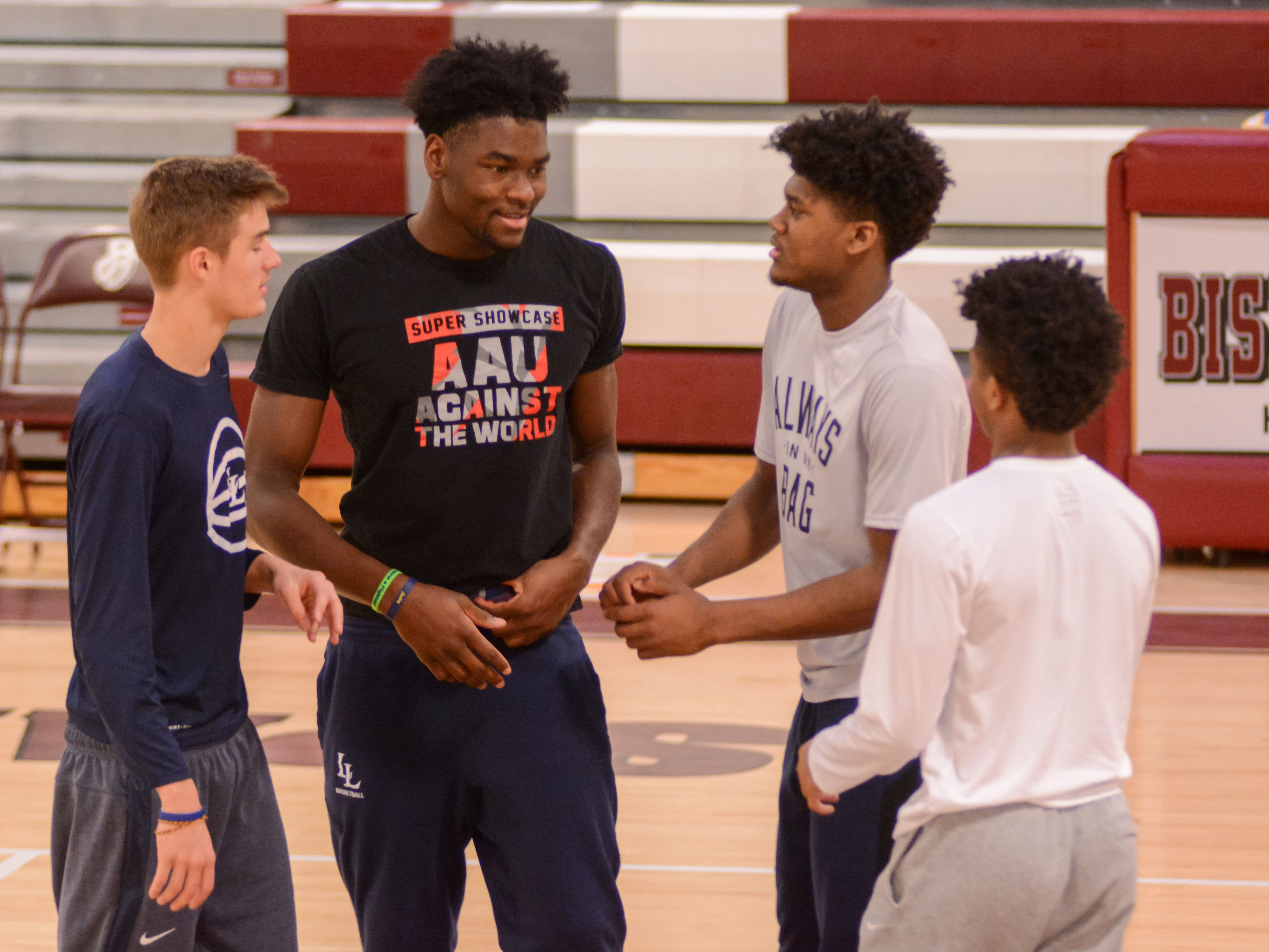 Isaiah Stewart, second from left, and Gerald Drumgoole, second from right, chat with teammates at the Bob Kirk Invitational in Cumberland, Maryland. Both Stewart and Drumgoole left Rochester to pursue their basketball dreams at the La Lumiere School in La Porte, Indiana.