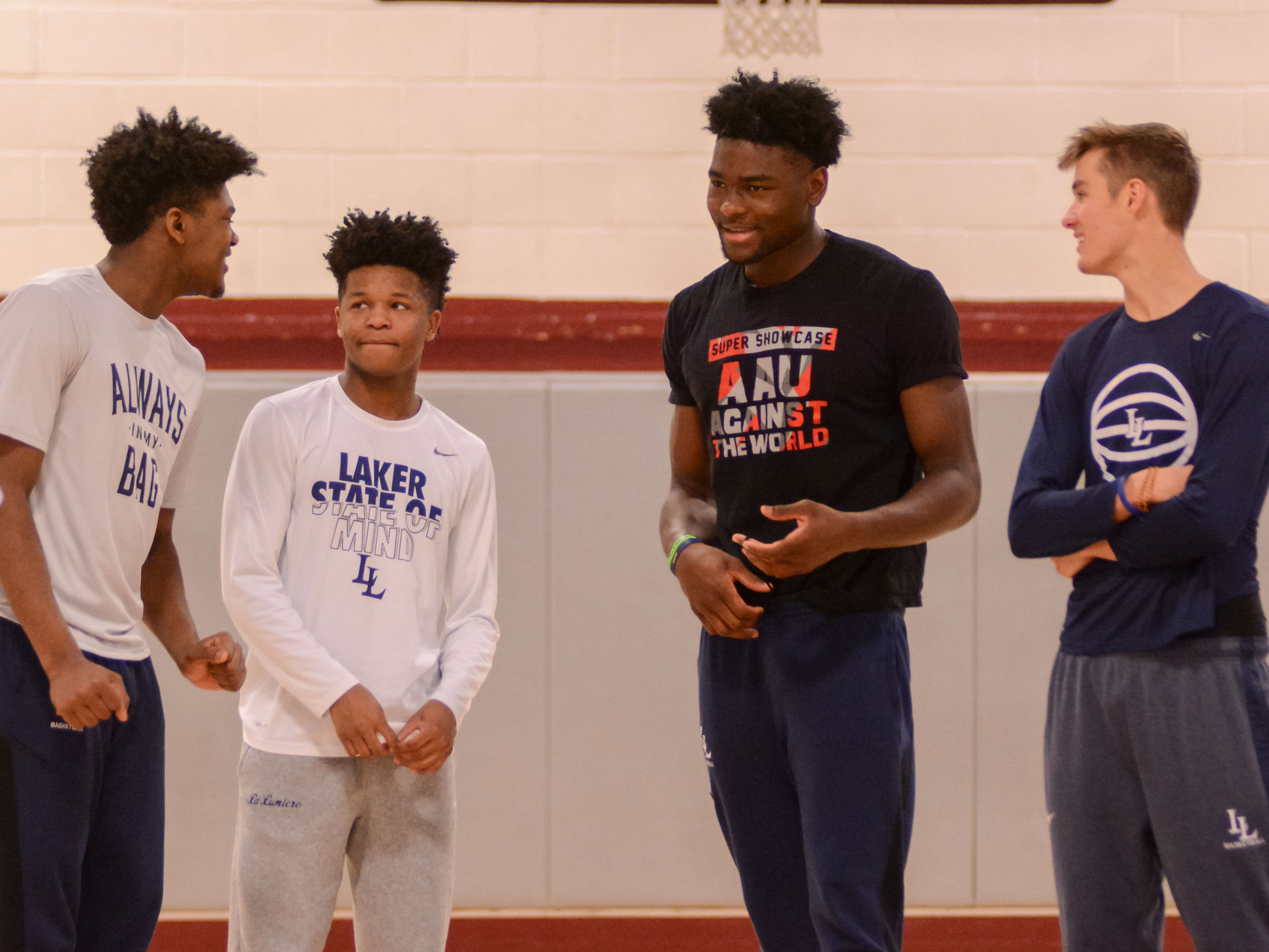 Gerald Drumgoole, left, and Isaiah Stewart, second from right, joke with a couple of La Lumiere School teammates before a game at the Bob Kirk Invitational in Cumberland, Maryland.