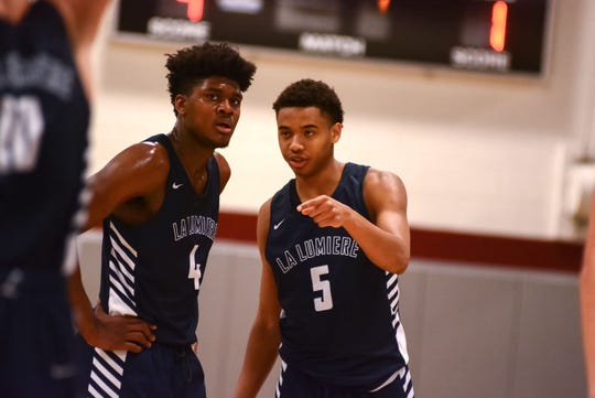 Former Irondequoit standout Gerald Drumgoole listens to La Lumiere teammate Desmond Polk during a 95-67 win over Takoma Academy at the Bob Kirk Invitational in Cumberland, Maryland.