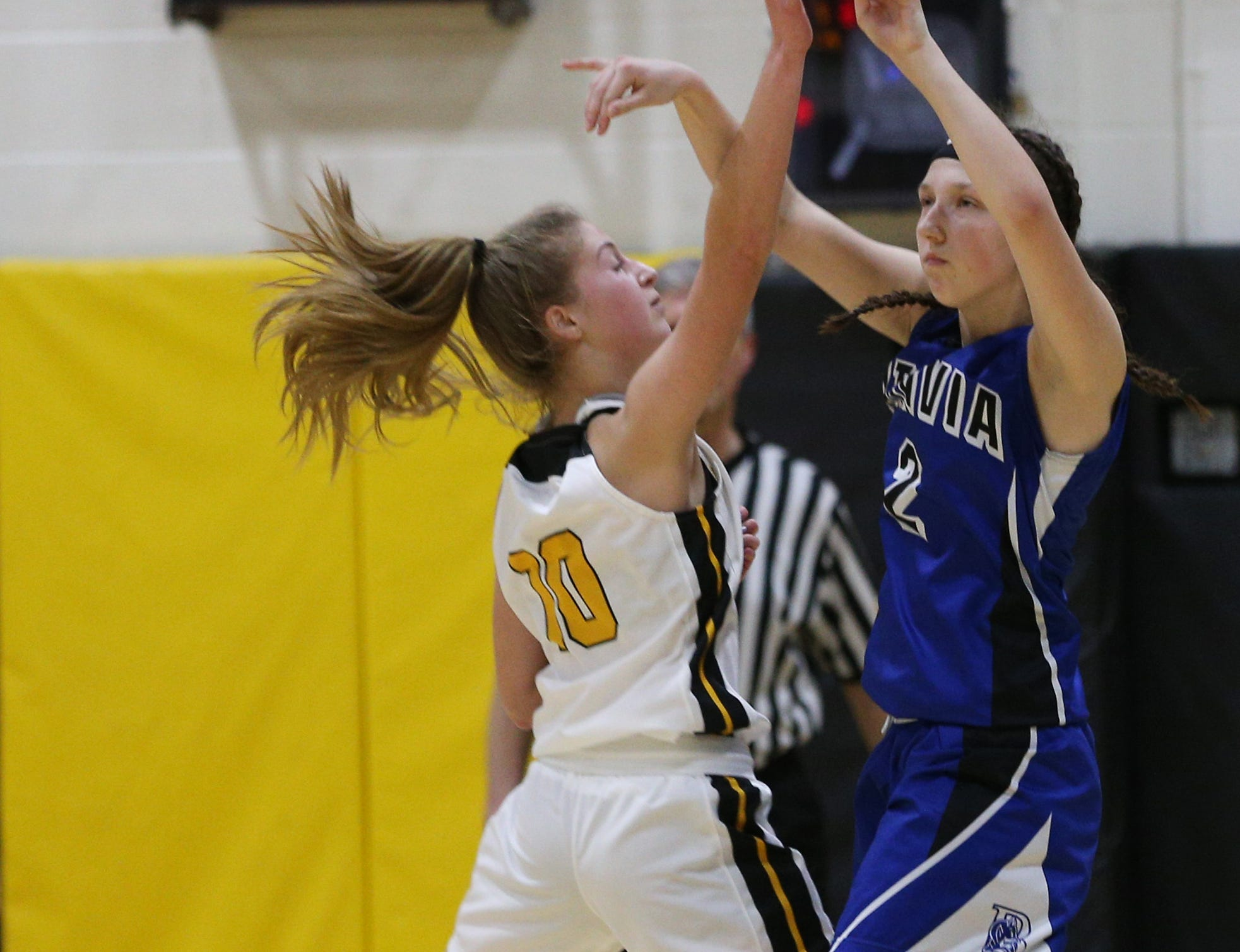 HF-L's Hannah Selke (10) tries to block Batavia's Bryn Wormley (2).
