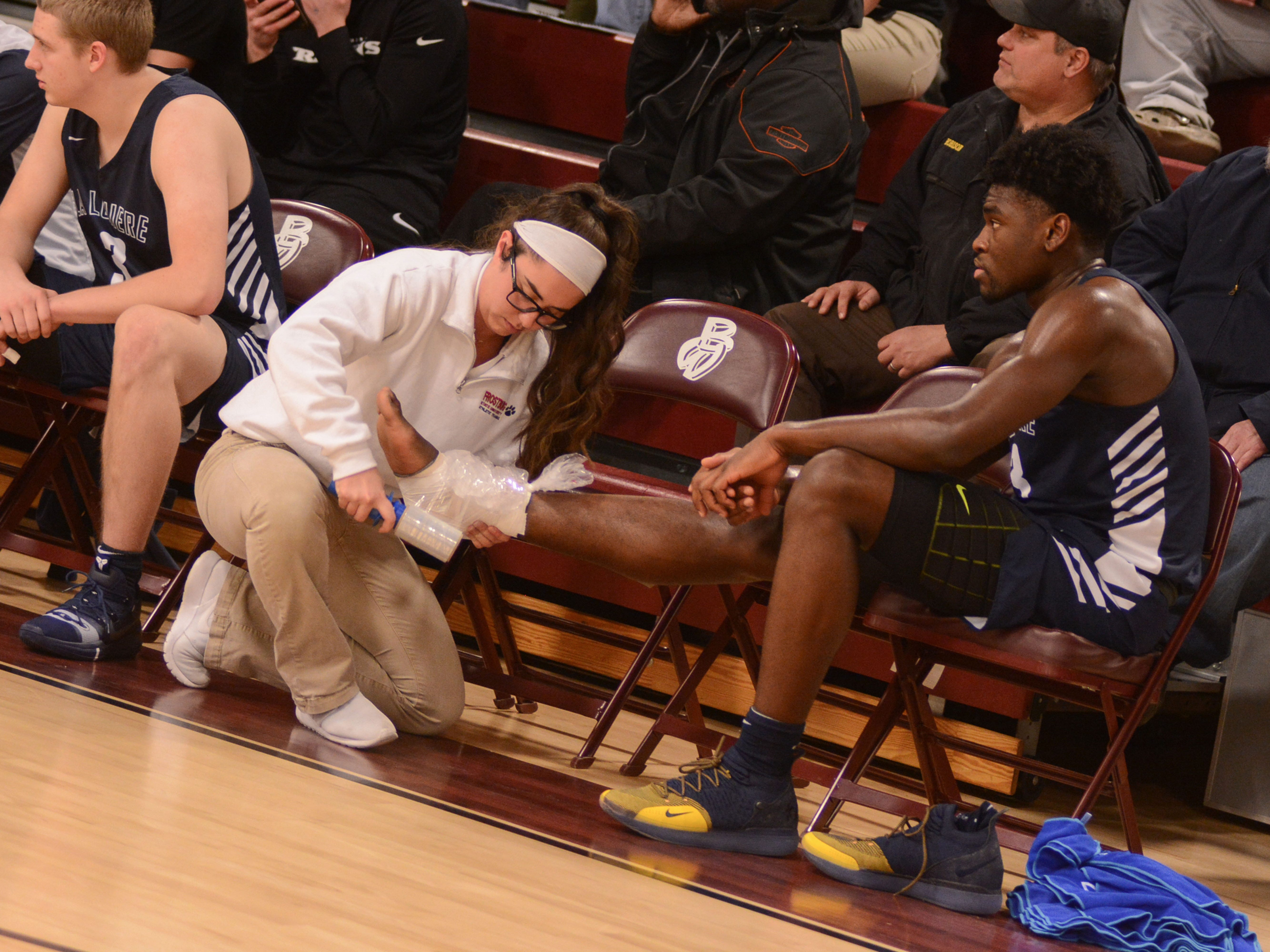 Former McQuaid star Isaiah Stewart, who is in his second season at the La Lumiere School in La Porte, Indiana, has his ankle attended to by a trainer during the Bob Kirk Invitational Tournament in Cumberland, Maryland