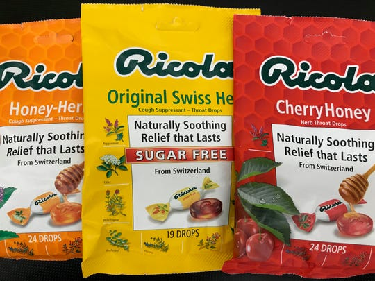 "Packes of Ricola throat lozenges that contain the phrase ""naturally soothing."""