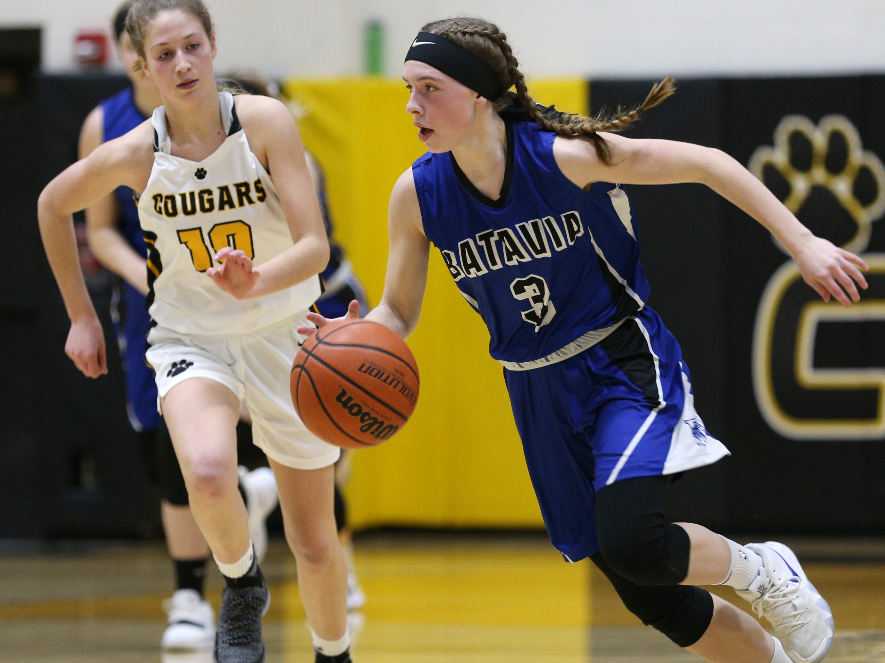 Batavia's Mackenzie Reigle (3) goes upcourt against Honeoye Falls-Lima's Hannah Selke (10).