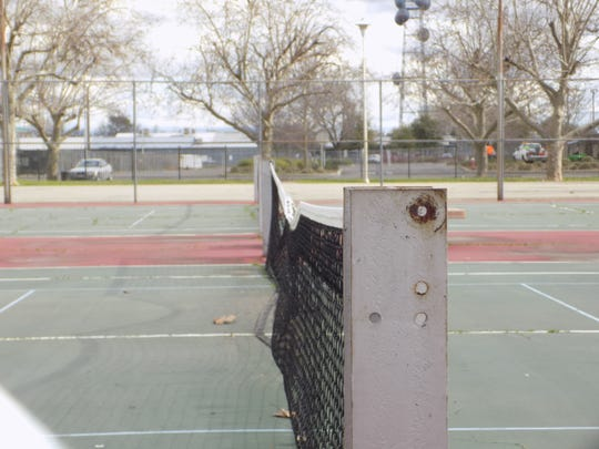 The tennis courts at South City Park have seen better days.