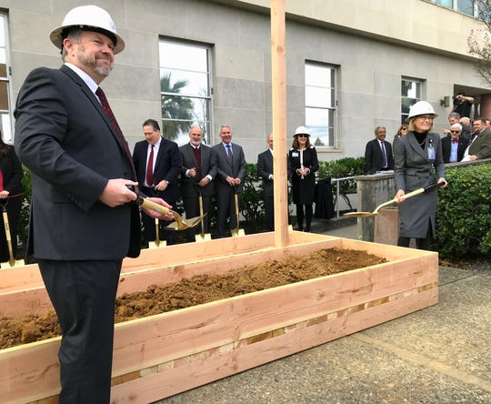 Shasta County Superior Court Presiding Judge Dan Flynn, left, and Court Executive Officer Melissa Fowler-Bradley shovel ceremonial dirt Friday at the groundbreaking for the new county courthouse, which is being built across the street.