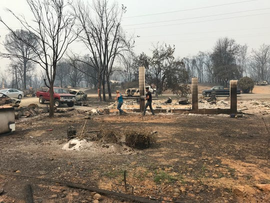 Residents, who live along Market Street in Keswick, clean up in February 2019 after the Carr Fire burned through the area in July 2018.