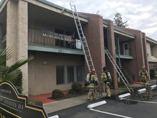 Firefighters quickly put out a blaze that was contained to a concrete column at a Redding law office on Friday, Feb. 8, 2019.