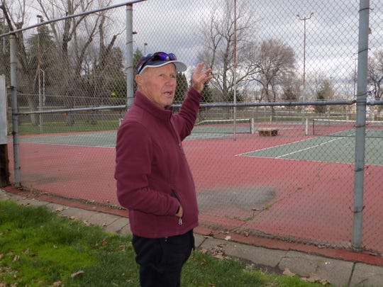 Terry Ehlers stands outside the tennis courts at South City Park. Ehlers is working with a group of people who want to revive tennis at the park.