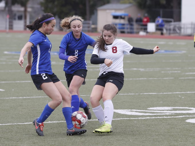 From left: Eila Chin, Rebecca Gaido and Brooke Keown fight for possession during the U-Prep's 4-1 win at home over West Valley on Thursday, Feb. 7, 2019.