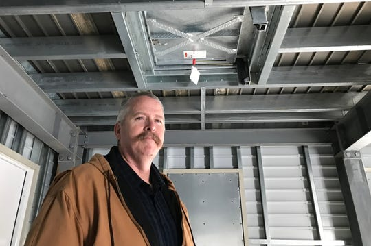 Don Lacy, interim director of fire technology and emergency medical services at Shasta College, stands in one of the two new firefighter training towers for fire academy students.