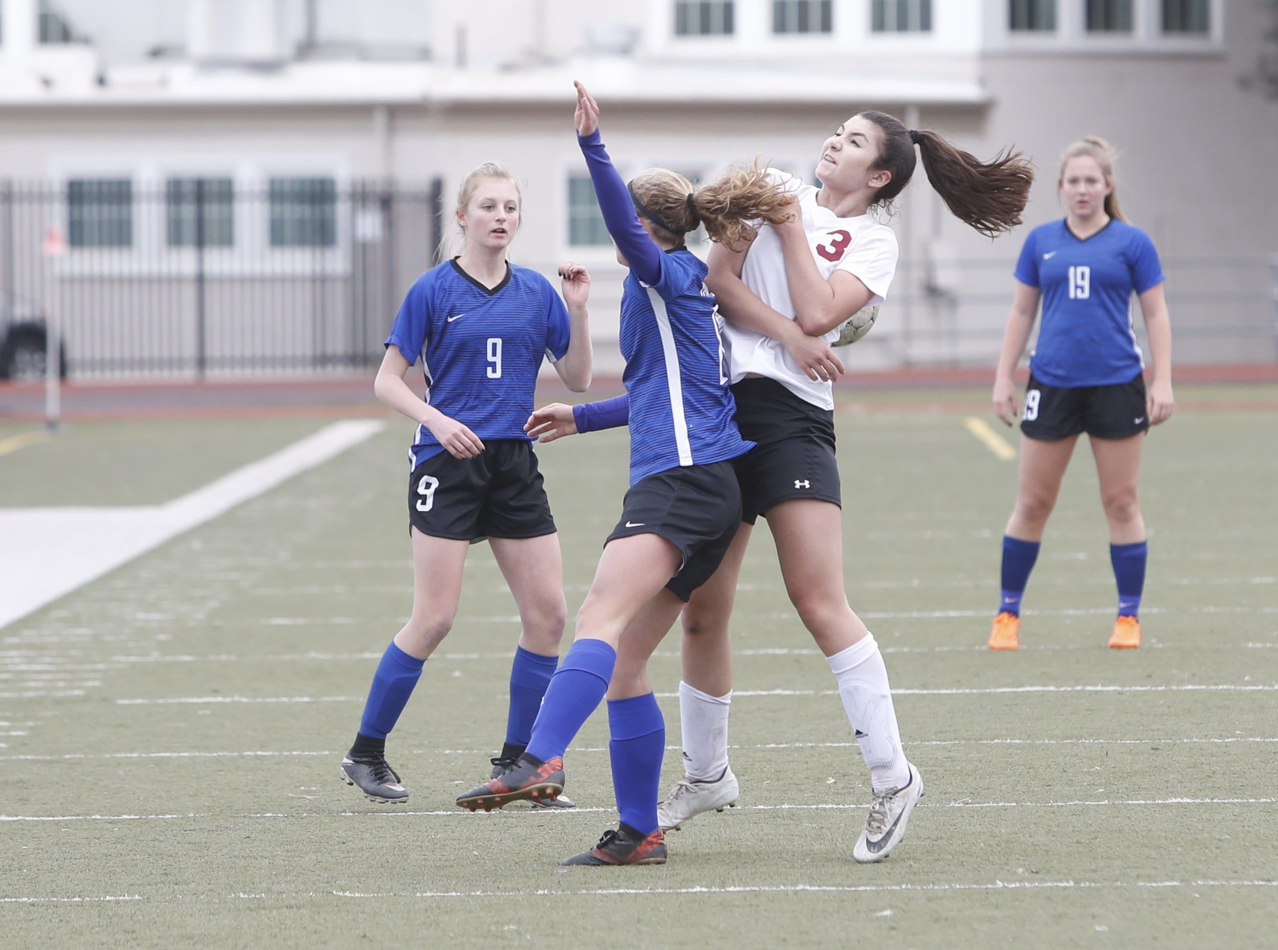 U-Prep freshman Rebecca Gaido and West Valley sophomore Bianca Jones fight to control a ball in the air during the Panthers' 4-1 win at home over West Valley on Thursday, Feb. 7, 2019.