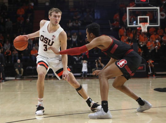 Oregon State's Tres Tinkle (3) looks for an opening around Stanford's KZ Okpala during the second half of an NCAA college basketball game in Corvallis, Ore., Thursday, Feb. 7, 2019. Stanford won 83-60.