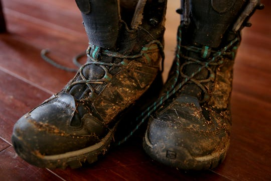The boots Leslie Drapiza was wearing when she hurt her ankle and fell while hiking on Mount Defiance in the Columbia River Gorge on Sunday are still damp and covered in mud. She spent about 40 hours in the freezing temperatures and snow before rescuers were able to get her out. Photographed at her home in Silverton on Thursday, Feb. 7, 2019.