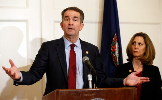 In this Feb. 2, 2019, photo, Virginia Gov. Ralph Northam, left, accompanied by his wife, Pam, speaks during a news conference in the governor's mansion in Richmond, Va. Democrats are hoping there's a silver lining to the Northam mess - that it shows they won't tolerate racism. Every level of the party has condemned the Democratic Virginia governor and demanded he step down. That follows disclosure that his medical school yearbook page features photos of a man in blackface standing with someone dressed in Klu Klux Klan attire.